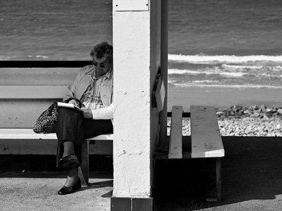 Old woman waiting at bus stop