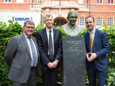 Professor Alan Thompson and Professor Nick Fox with Paul Ramsbottom, Chief Executive of the Wolfson Foundation with the bust of Lord Wolfson in Queen Square.