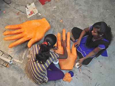 Dharavi inhabitants working on an art project