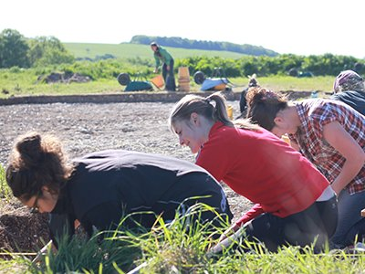 Archaeology students on a dig
