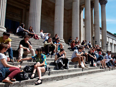Students sitting on the Portico steps